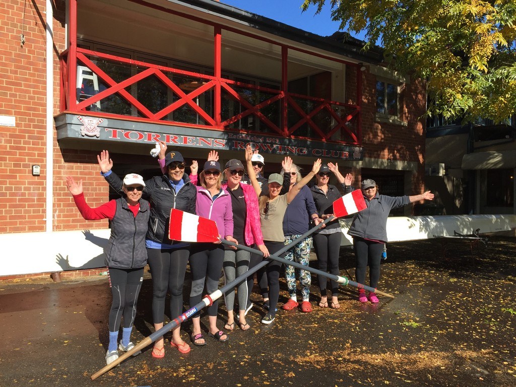 Recent learn to row group photo in front of the City boat-shed.